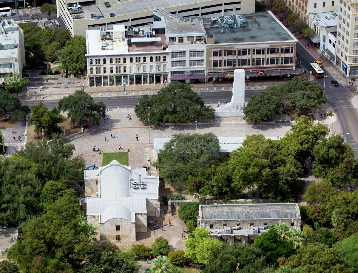 Alamo Plaza, with the Alamo at the bottom left corner, is seen in a Thursday Oct. 8, 2015 aerial photo. The while marble cenotaph can be sent the right of the image in front of three building the Texas General Land Office recently agreed to buy.