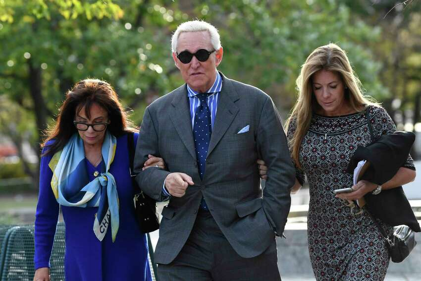 Roger Stone, his wife Nydia, left, and daughter Adria, leave federal court in Washington, Friday, Nov. 8, 2019. after his trial ended for the day. (AP Photo/Susan Walsh)