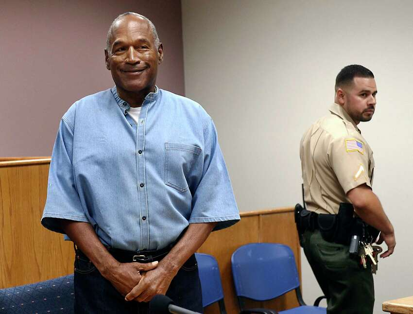 FILE - In this July 20, 2017, file photo, former NFL football star O.J. Simpson enters his parole hearing at the Lovelock Correctional Center in Lovelock, Nev. Simpson is suing a Las Vegas hotel-casino, alleging unnamed employees defamed him by telling celebrity news site TMZ he was ordered off the property in 2017 for being drunk, disruptive and unruly. (Jason Bean/The Reno Gazette-Journal via AP, Pool, File)