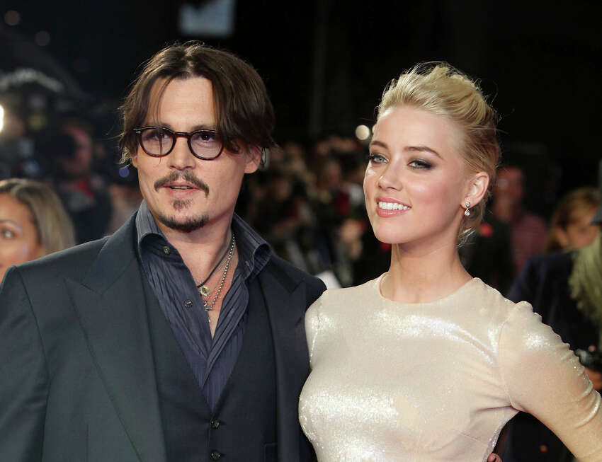 FILE - In this Nov. 3, 2011 file photo, U.S. actors Johnny Depp, left, and Amber Heard arrive for the European premiere of their film,