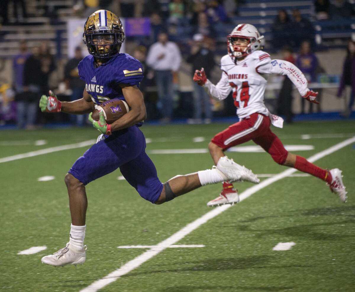 Midland High's Daniel Garcia checks for defenders as on his way to a touchdown as Odessa High's John Almance tries to catch him 11/08/19 at Grande Communications Stadium. Tim Fischer/Reporter-Telegram