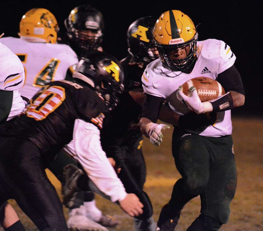 Hamden's Davone Mitchell rushes against Amity in the Green Dragons 15-8 SCC win Friday, Nov. 8, 2019. Photo: Dave Phillips / For Hearst Connecticut Media