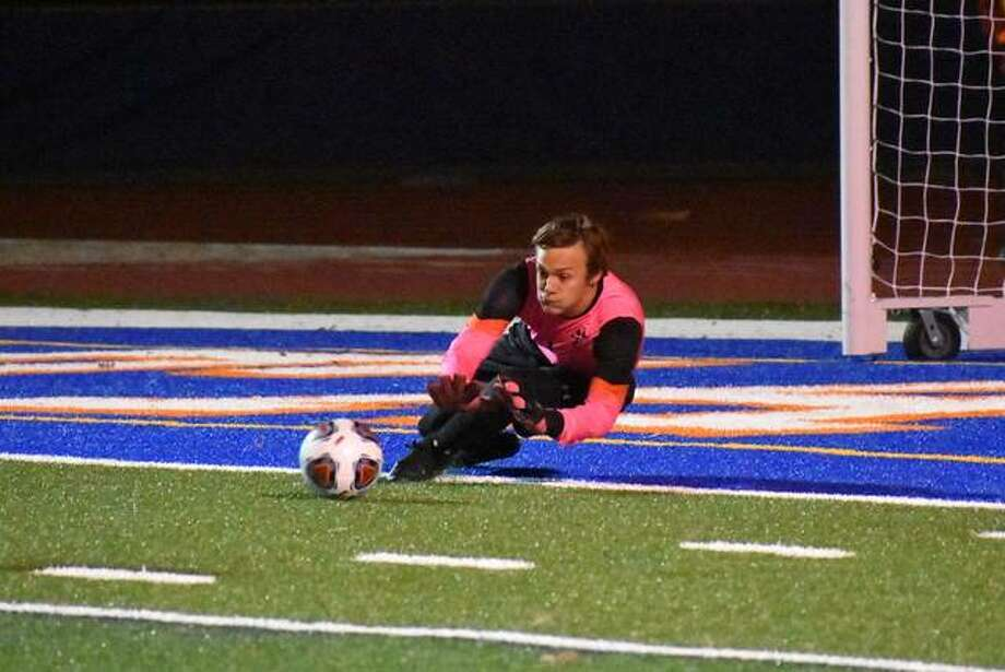Edwardsville keeper Tyler Frolik makes a diving save in the first half of the Class 3A state semifinals at Hoffman Estates High School. He made 12 saves. Photo: Matt Kamp|The Intelligencer