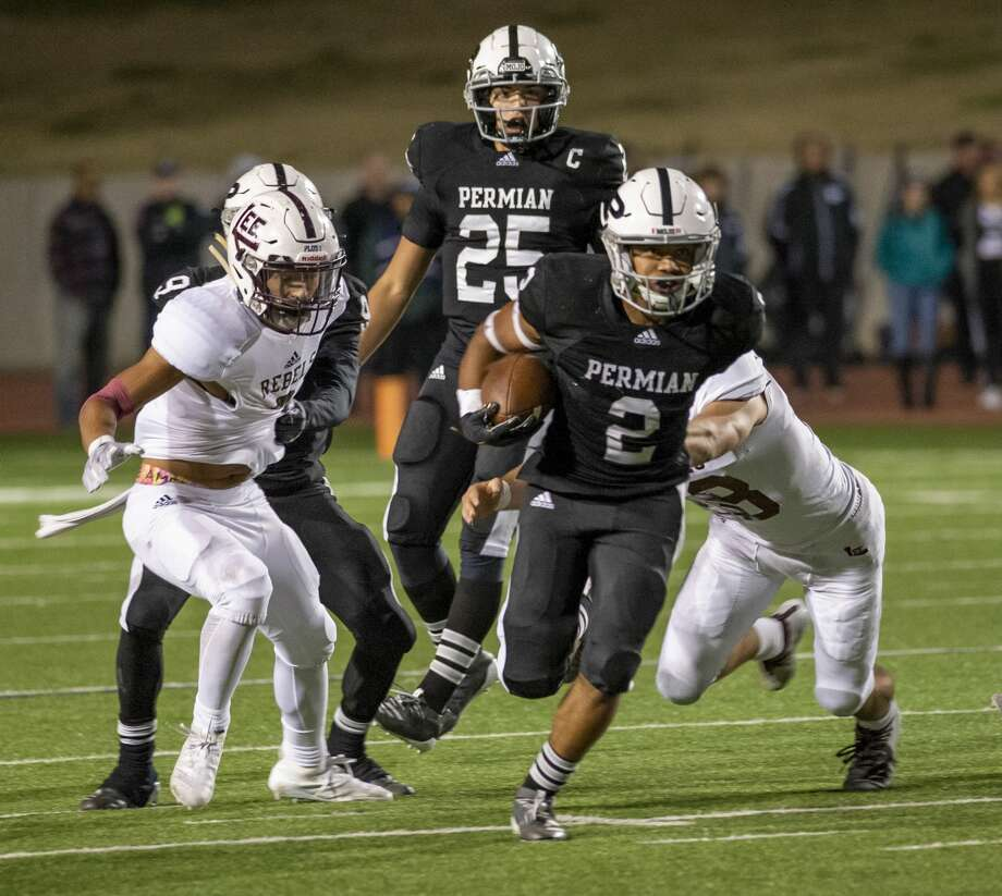 Odessa Permian's Alex Rose (2) evades Lee's Karl Taylor and Trent Low on Friday, Nov. 8, 2019 at Ratliff Stadium. Photo: Jacy Lewis/Reporter-Telegram