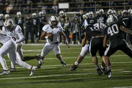 Lee's Mikey Serrano (4) runs the ball through an opening of Odessa Permian defenders Friday, Nov. 8, 2019 at Ratliff Stadium.