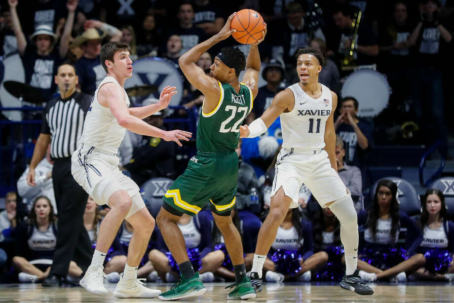 Siena's Jalen Pickett had 18 points against No. 19 Xavier, 14 coming in the first half. (John Minchillo/Associated Press) Photo: John Minchillo (Associated Press)