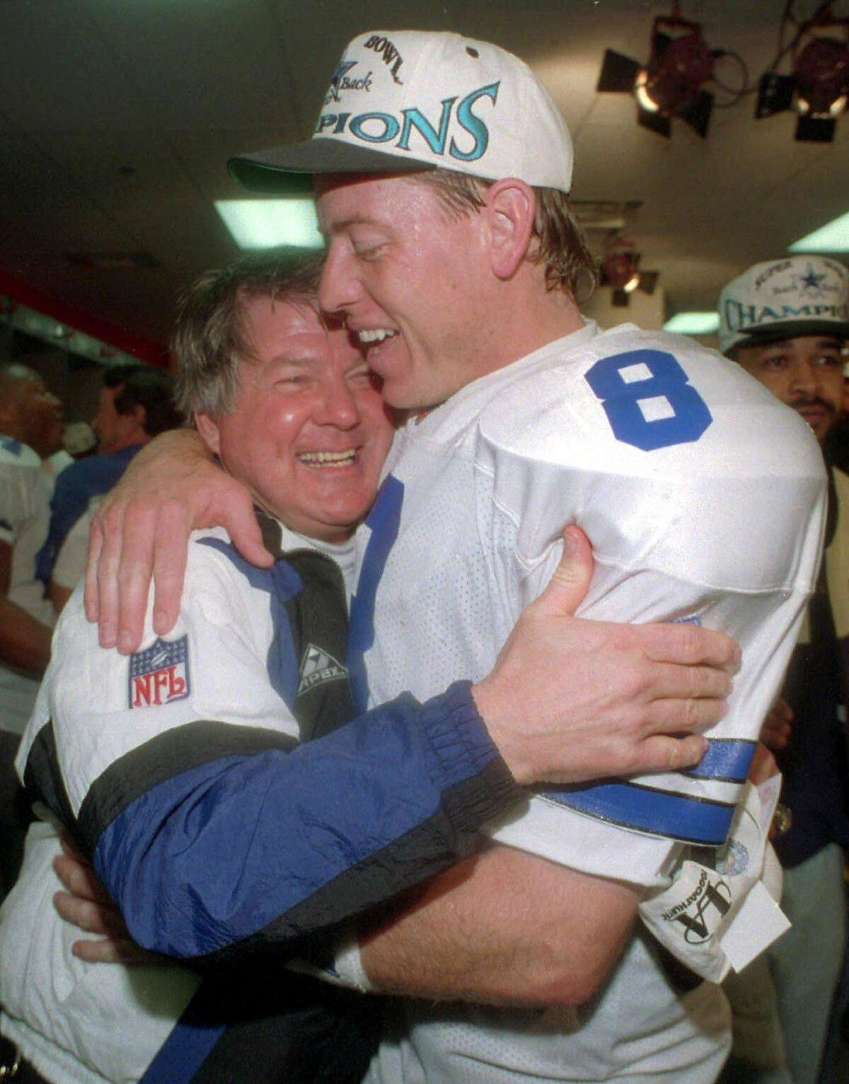 Dallas Cowboys head coach Jimmy Johnson hugs quarterback Troy Aikman in their locker room after beating the Buffalo Bills 30-13 in Super Bowl XXVIII at Atlanta's Georgia Dome, Jan. 30, 1994. No longer convinced that Aikman can remain healthy enough to be their starter, the Dallas Cowboys waived Wednesday, March 7, 2001, the quarterback who led them to three Super Bowl titles.. (AP Photo/Charles Krupa)