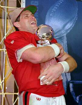 ** FILE ** San Francisco 49ers quarterback Steve Young hugs the Lombardi trophy  after beating the San Diego Chargers 49-26 in Super Bowl XXIX at Miami's Joe Robbie Stadium,  in this Jan. 29, 1995 photo. (AP Photo/Eric Risberg)  Ran on: 08-04-2005 Steve Young reached the top of the football world in January of 1995, guiding the 49ers past the Chargers in Super Bowl XXIX.  Ran on: 08-04-2005 Steve Young reached the top of the football world in January of 1995, guiding the 49ers past the Chargers in Super Bowl XXIX.  Ran on: 02-06-2011 Steve Young hugs the Lombardi Trophy after beating the Chargers.