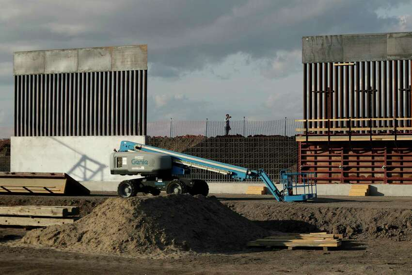 The first panels of levee border wall are seen at a construction site along the U.S.-Mexico border, Thursday, Nov. 7, 2019, in Donna, Texas. The new section, with 18-foot tall steel bollards atop a concrete wall, will stretch approximately 8 miles. (AP Photo/Eric Gay)
