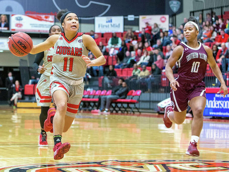 Mikia Keith of SIUE (11) drives to the basket against SIUC's Brittney Patrick during Friday night's game at SIUE. Photo: Scott Kane | SIUE Athletics