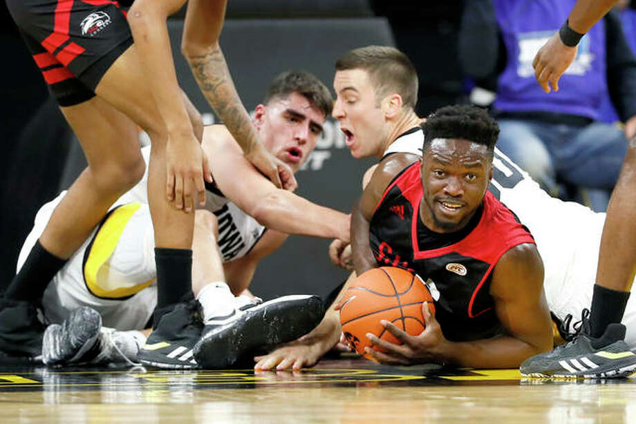 SIUE's Anselm Uzuegbunem, right, fights for a loose ball with Iowa's Luka Garza, left, and Connor McCaffery during Friday nights game in Iowa City, Iowa. Photo: Charlie Neibergall | AP Photo