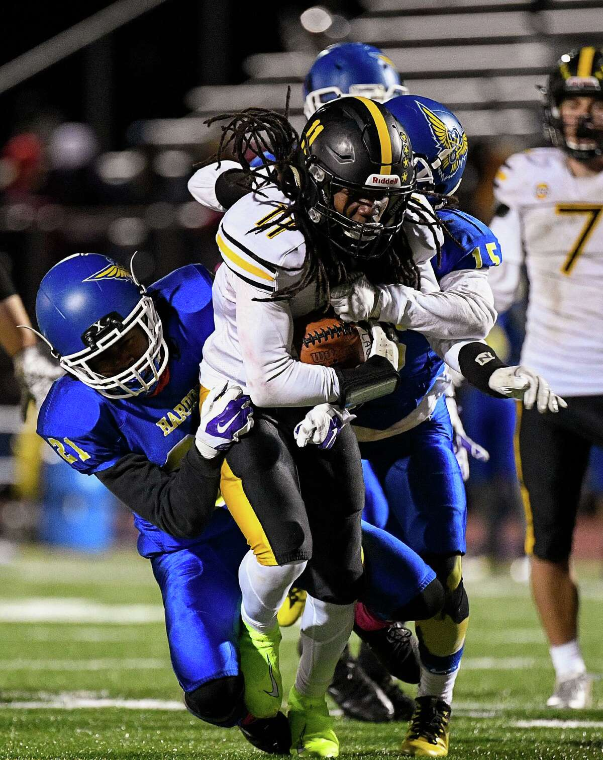 Law's Curtis Murphy fights for extra yards against the Harding defense. Harding High defeated Jonathan Law, 40-21, at Harding High in Bridgeport, Friday, November 8, 2019