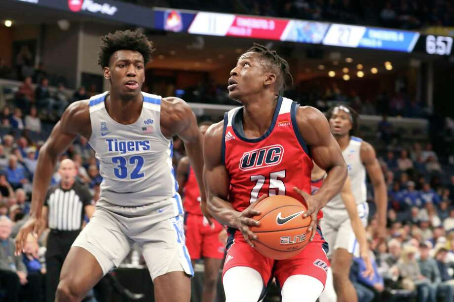 Memphis James Wiseman (32) guards Illinois-Chicago Godwin Boahen (25) during the first half of an NCAA college basketball game Friday, Nov. 8, 2019, in Memphis, Tenn. (AP Photo/Karen Pulfer Focht) Photo: Karen Pulfer Focht / Copyright 2019 The Associated Press. All rights reserved