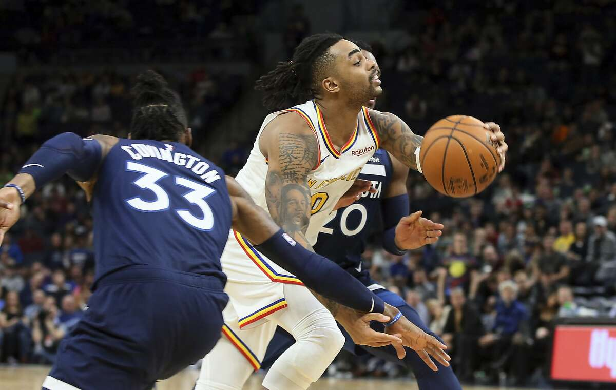 Golden State Warriors' D'Angelo Russell, center, drives between Minnesota Timberwolves' Robert Covington, left, and Josh Okogie, of Nigeria, in the second half of an NBA basketball game Friday, Nov 8, 2019, in Minneapolis. (AP Photo/Jim Mone)