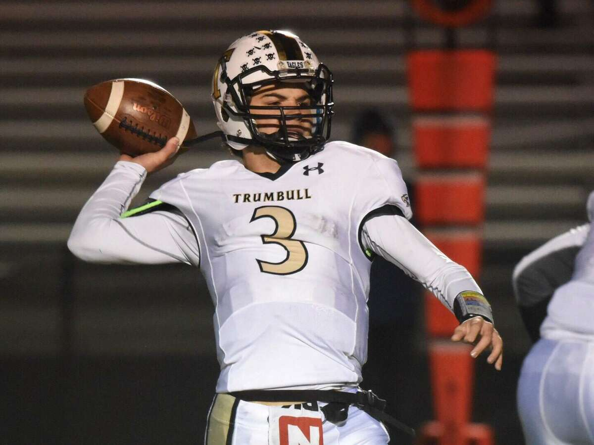 Trumbull QB Riley Simpson (3) throws a touchdown pass during a football game against New Canaan at Dunning Field on Friday, Nov. 8, 2019.