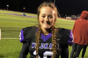 Quarterback Emilee Buhl made history Friday as the first female to make it through Willis' football program and onto the varsity squad