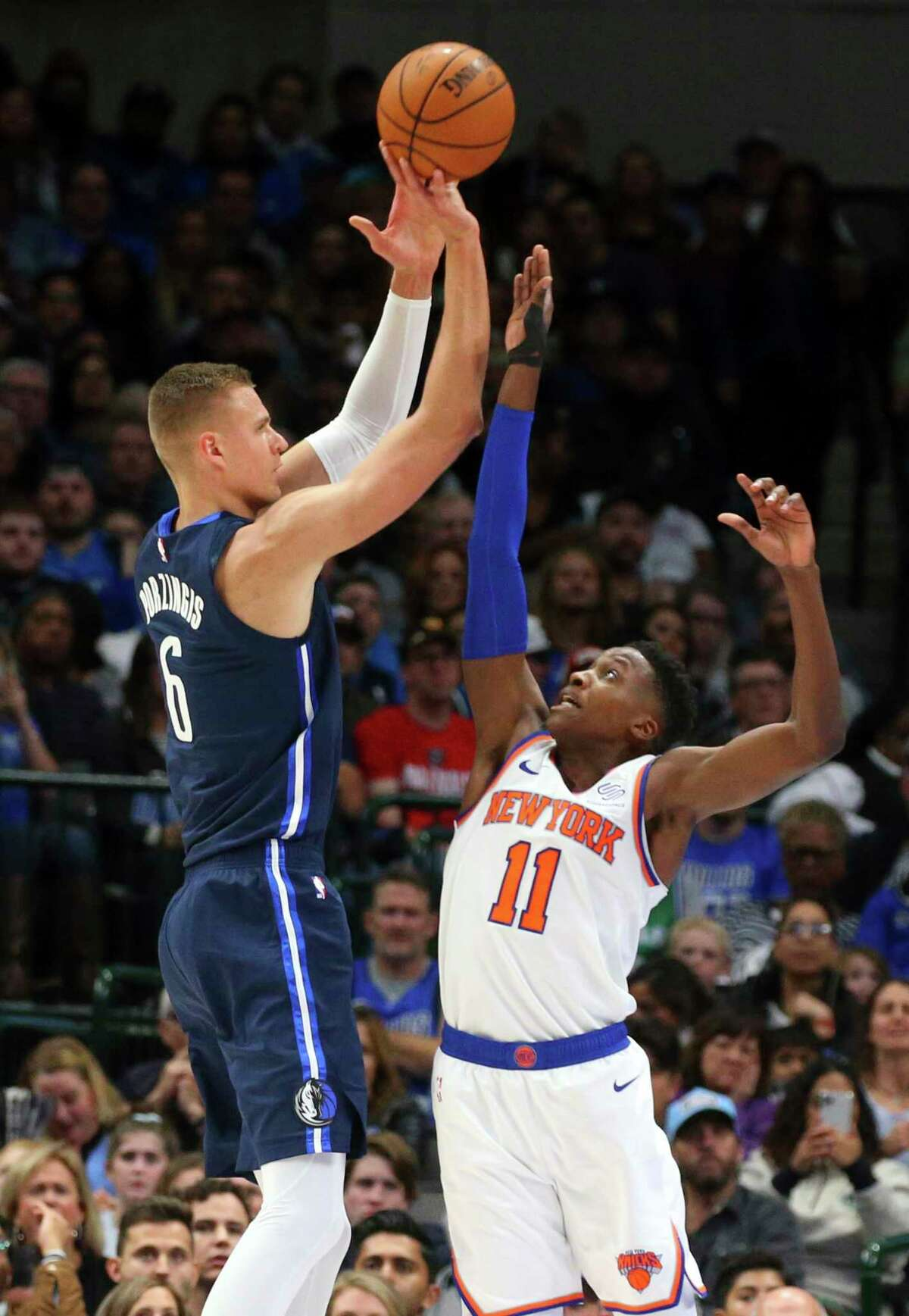 Dallas Mavericks forward Kristaps Porzingis (6) puts up a shot over New York Knicks guard Frank Ntilikina (11) in the first half of an NBA basketball game Friday, Nov. 8, 2019, in Dallas. (AP Photo/Richard W. Rodriguez)