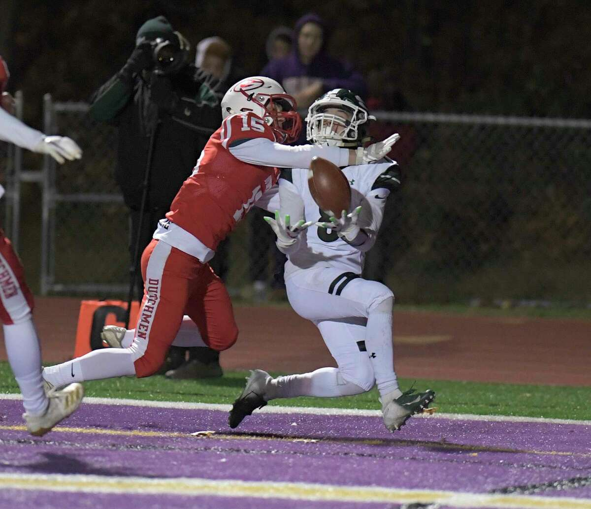 Shendehowa's Joshua Szwarcberg (8) catches a pass for a touchdown in front of Guilderland's Devon Mcclaine (15) during a Section II Class AA high school Super Bowl football game Friday, November 8, 2019, in Troy, N.Y. Shenendehowa won the game. 35-7. (Hans Pennink / Special to the Times Union)