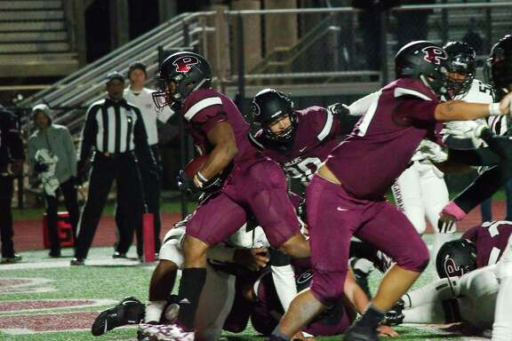 Pearland's Brandon Campbell (7) finds a hole in the George Ranch defense for a touchdown Friday at The Rig.