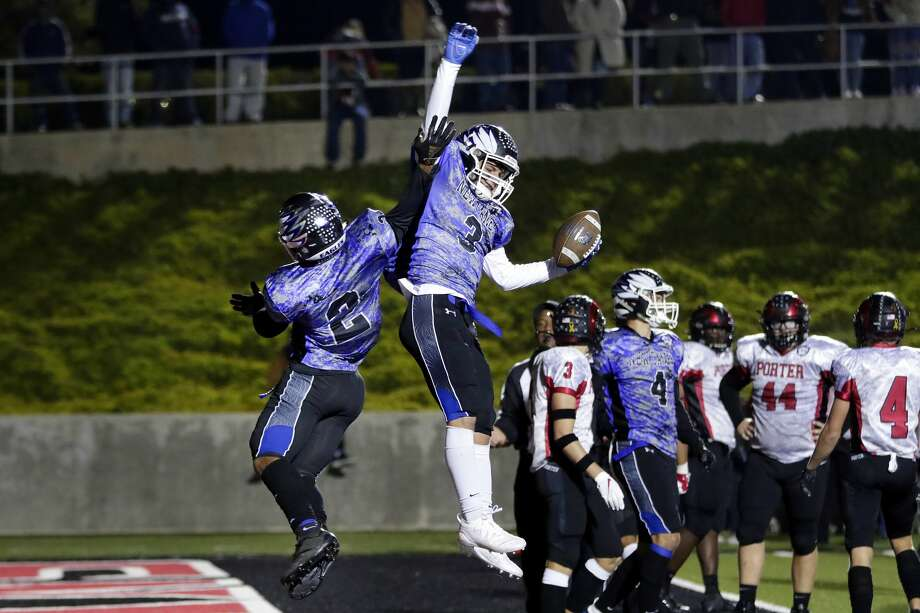 New Caney's Billy Williams (2) and Isaiah Akin (3) celebrate Akin's touchdown against Porter during the first half of their District 9-5A high school football game Friday, Nov. 8, 2019 in New Caney, TX. Photo: Michael Wyke/Contributor