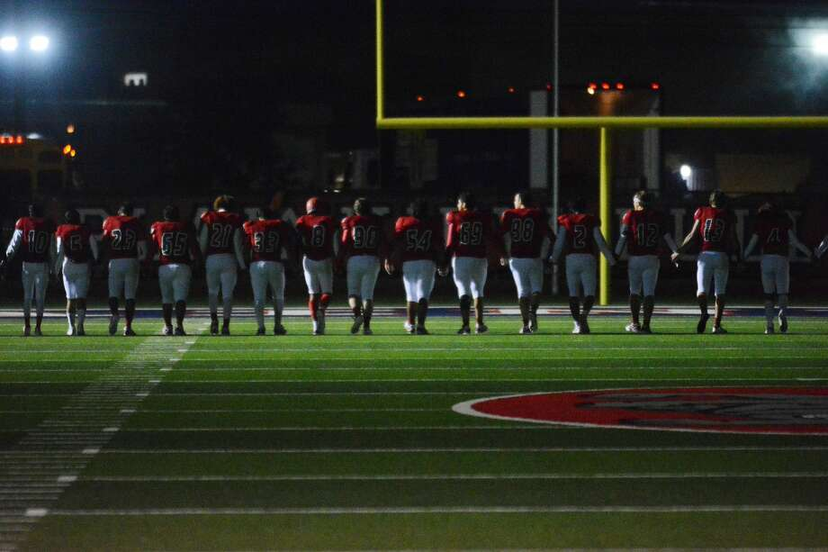 Seniors of the Plainview football team walk the length of Greg Sherwood Memorial Bulldog Stadium hand-in-hand after the conclusion of the final game of their high school careers on Friday. Photo: Nathan Giese/Planview Herald