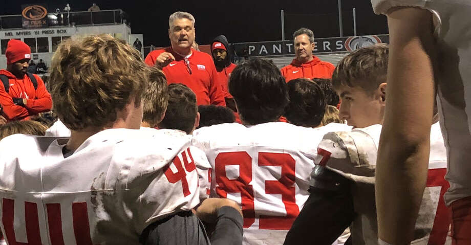 St. Thomas head coach Rich McGuire talks to his team after a win over St. Pius X on Friday, Nov. 8, 2019. Photo: Elliott Lapin