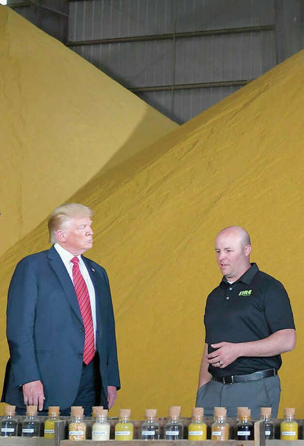 President Donald Trump looks at corn samples used for biofuel production. Photo: Mandel Ngan   AFP (Getty Images)