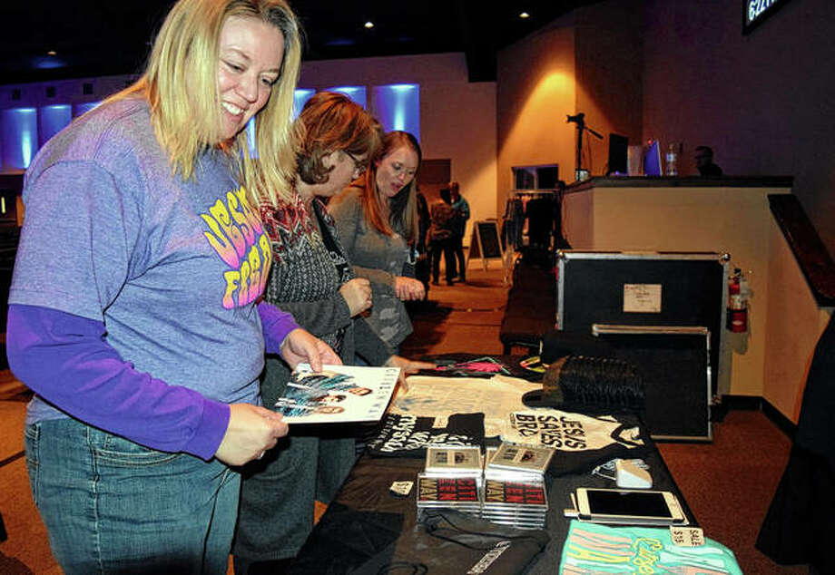Ramona Haley of Jacksonville looks over Citizen Way merchandise Friday at First Christian Church during the Love is a Lion Tour with Citizen Way. Photo: Samantha McDaniel-Ogletree | Journal-Courier