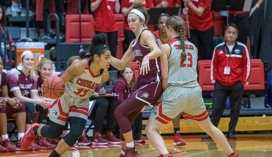 SIUC guard Makenzie Silvey, center, scored a team-high 28 points to lead the Salukis to a win in her return home to Edwardsville. Photo: Scott Kane/For The Intelligencer