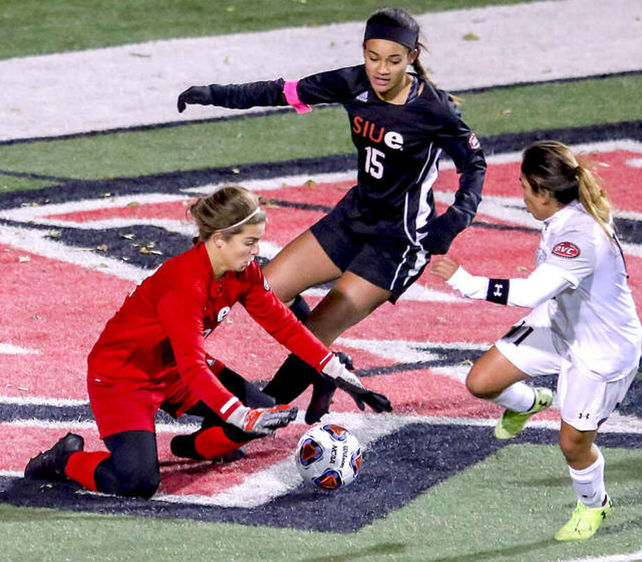 SIUE goalie Jensen Schoch, left covers the ball in front of Southeast Missouri's Esmie Gonzales (11) in Friday's Ohio Valley Conference Tournament semifinal game in Cape Girardeau. Also pictured is SIUE's Alexis royal. Photo: SIUE Athletics