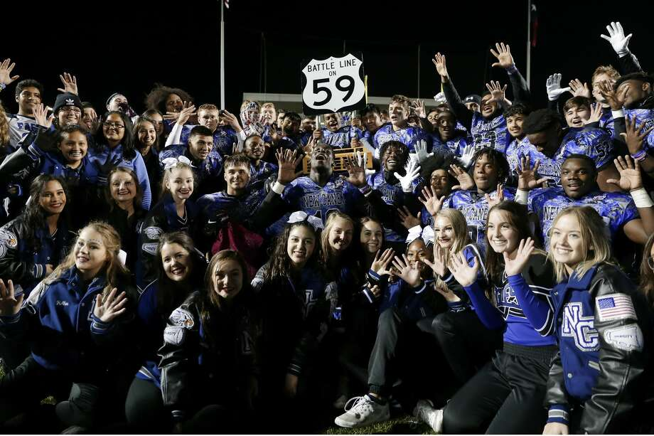 "The New Caney Eagles celebrate with the ""Stateline on 59"" trophy after their win against Porter in their District 9-5A high school football game Friday, Nov. 8, 2019 in New Caney, TX. Photo: Michael Wyke/Contributor"