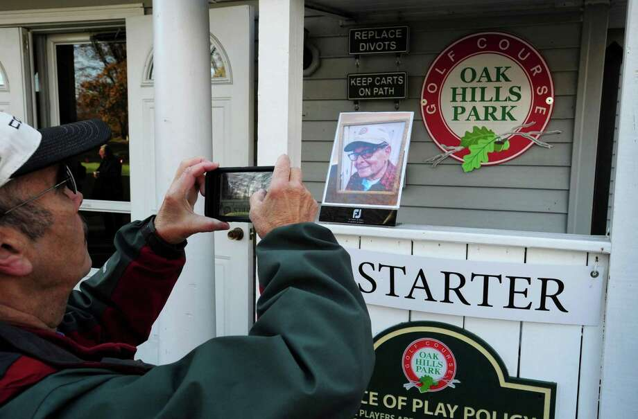 Co worker Joe Jimenez photographs a portrait of Peter Castellani as Oak Hill Park posthumously honors the Army and Navy veteran, park patron and employee who passed recently Saturday, November 9, 2019, at the park in Norwalk, Conn. Cassellini served in the United States Army, Private First Class 82nd Airborne Unit and later served with the United States Navy during the Korean War. Photo: Erik Trautmann / Hearst Connecticut Media / Norwalk Hour