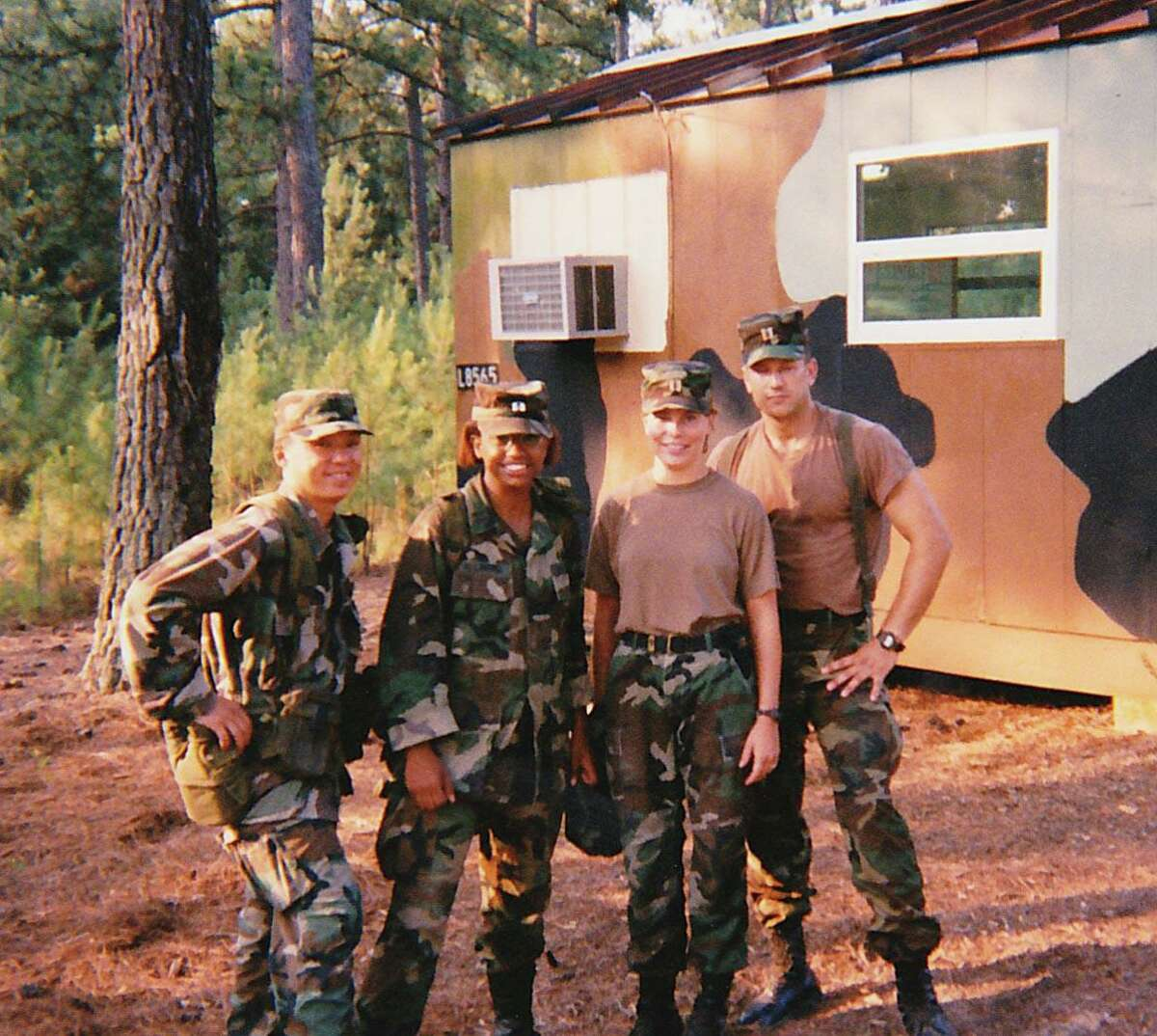 Bess Healy, second from right, served in the U.S. Army from 1994 to 2001, reaching the rank of captain.