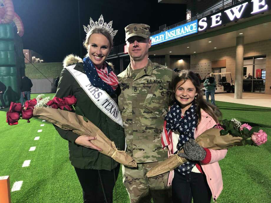 Sgt 1st Class Chance Jackowski, U.S. Army poses with his wife Shannon Dresser and daughter Lily Ann Jackowski, 11, during a Veteran's Day Ceremony at Legacy Stadium, Katy, Tx, Nov. 8, 2019.  Sgt. Jackowski surprised his family by returning from a one-year deployment in Korea. Shannon Dresser is a Katy ISD Officer and serves as Mrs. Texas. Photo: Craig Moseley, Staff Photographer / Houston Chronicle