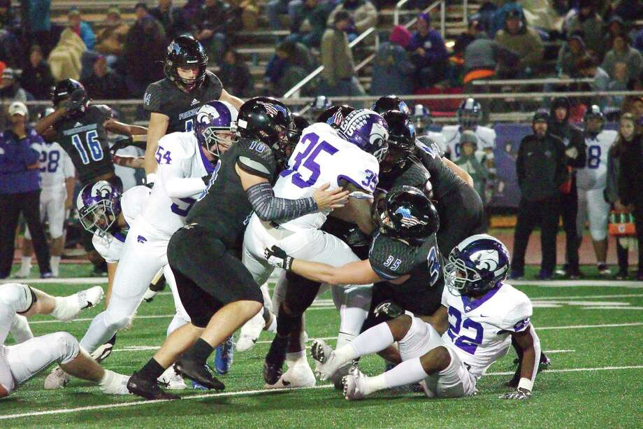 Angleton's J.T. Anderson (35) is wrestled down by Friendswood's Dane Roenne (10) and Jackson Stephens (35) Friday at Henry Winston Stadium. Photo: Kirk Sides / Staff Photographer / © 2019 Kirk Sides / Houston Chronicle