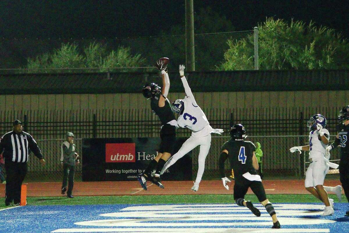 Friendswood's Christian Lee (6) makes an athletic catch over Angleton's Austin Fairchild (3) for a touchdown Friday at Henry Winston Stadium.