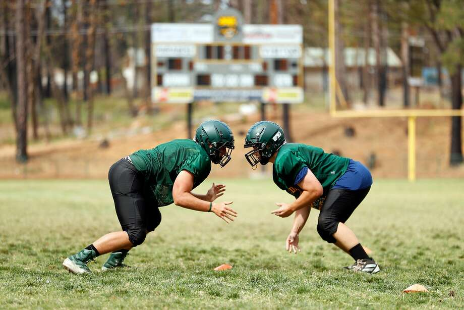 Two players face off during varsity football practice at Paradise High School in Paradise, Calif., on Wednesday, August 21, 2019. Photo: Scott Strazzante / The Chronicle