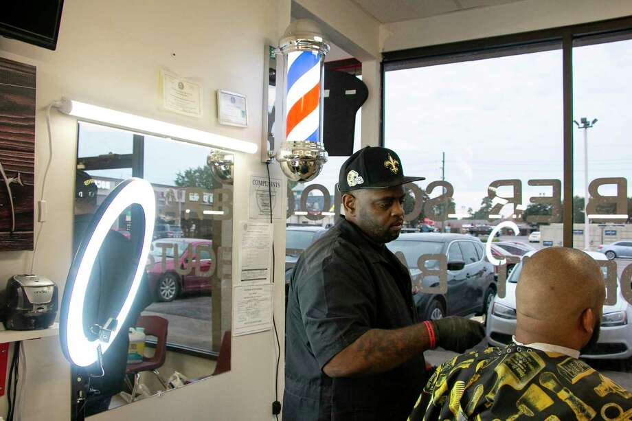 Billy Henry, owner and instructor of Five Star Elite Fades Barber College, works in his shop. Photo: Savannah Mehrtens/Staff Photo / Savannah Mehrtens/Staff Photo