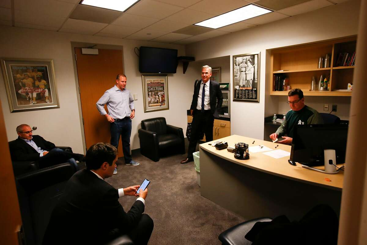 NEW YORK, NY - OCTOBER 3: President David Kaval, Assistant General Manager, Pro Scouting & Player Personnel Dan Feinstein, General Manager David Forst, Executive Vice President of Baseball Operations Billy Beane and Manager Bob Melvin #6 of the Oakland Athletics sit in the managers office in the clubhouse following the game against the New York Yankees in the American League Wild Card Game at Yankee Stadium on October 3, 2018 New York, New York. The Yankees defeated the Athletics 7-2. Zagaris/Oakland Athletics/Getty Images)