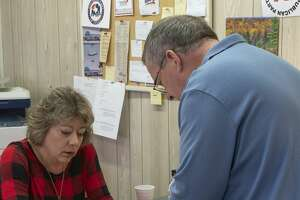 Sherri Merket, Midland County Republican Party Chair tells Russell Malm he needs to have his paperwork notarized before filing for Midland County Attorney 11/09/19 at Midland Republican headquarters. Tim Fischer/Reporter-Telegram