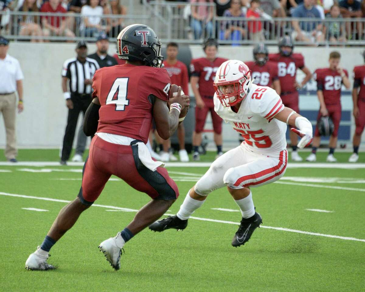 Jalen Milroe (4) of Tompkins is pressured by Shepherd Bowling (25) of Katy during the first quarter of a 6A Region III District 19 football game between the Katy Tigers and the Tompkins Falcons on Thursday, October 3, 2019 at Legacy Stadium, Katy, TX.