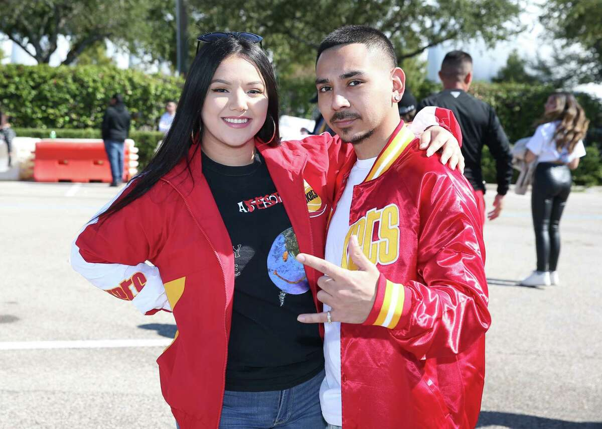 People pose for a photograph at Astroworld Festival on Saturday, Nov. 9, in Houston.