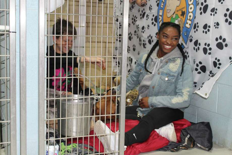 Spring resident and Olympic gold medalist Simone Biles shows her support for rescue animals during Abandoned Animal Rescue's A Night in the Dog House Fundraiser in Magnolia on Friday night, Nov. 8, 2019. Photo: Paul Wedding