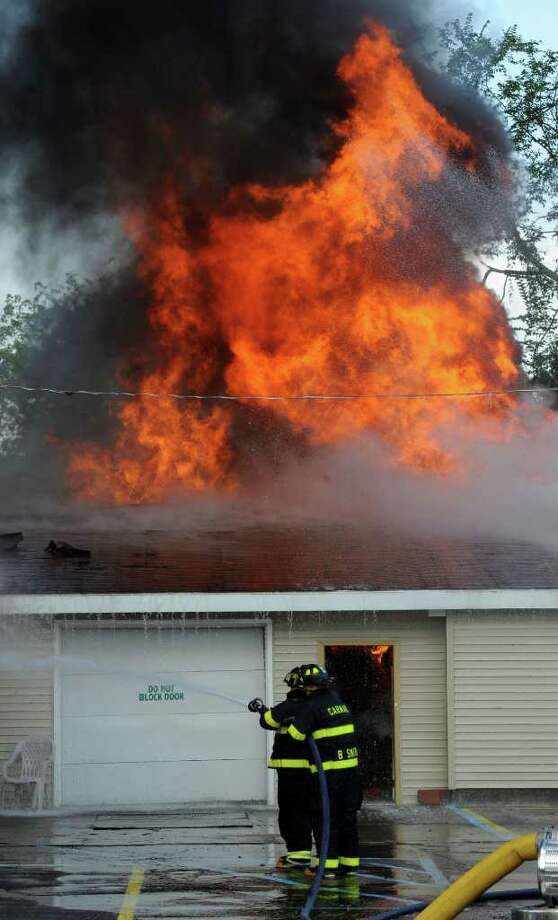 Fire companies from throughout Schenectady County fight a fire on Guilderland Avenue in Rotterdam on Tuesday, Aug. 10, 2010.       (Skip Dickstein/Times Union) Photo: Skip Dickstein / 2008
