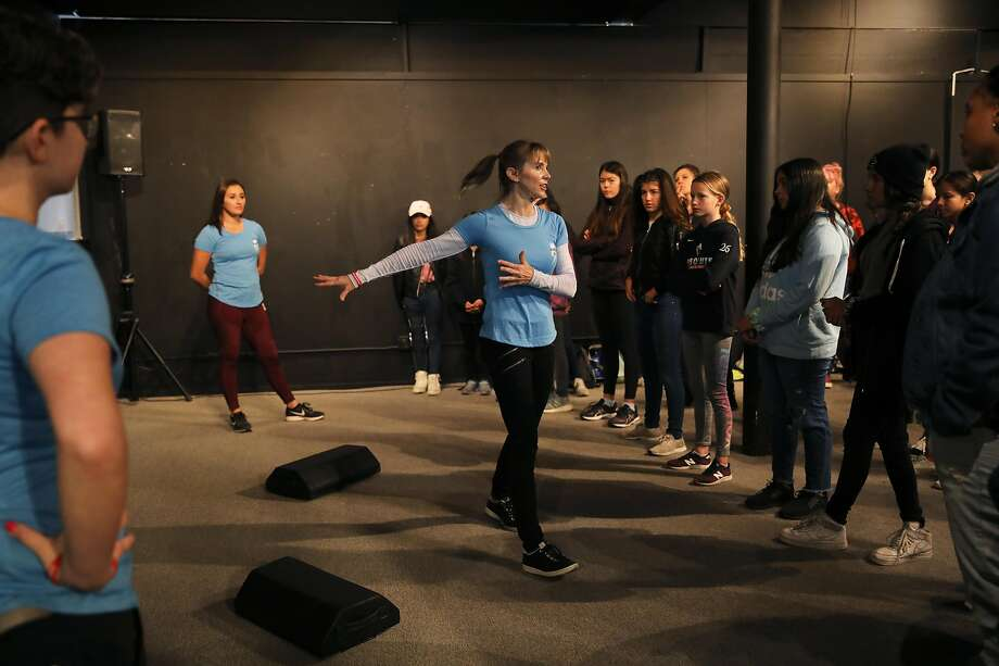 Stephanie Cyr (center), owner of Edge Self Defense, provides instructions for a self-defense move during a demonstration at the Girls' Festival at the Palace of Fine Arts in San Francisco. Photo: Yalonda M. James / The Chronicle