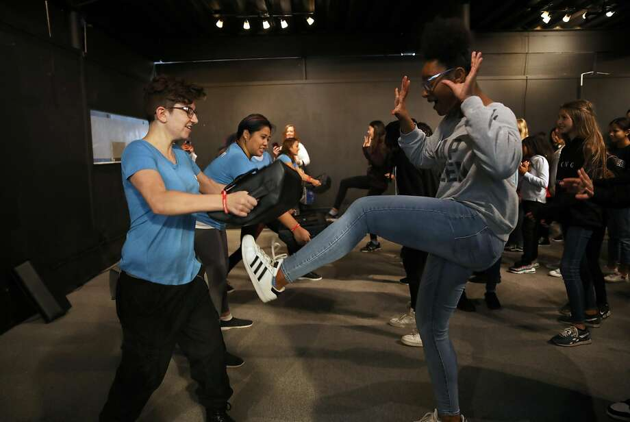 Iris Shavies of Antioch kicks a pad held by Sam Hengesbach in a self-defense demonstration. Photo: Photos By Yalonda M. James / The Chronicle