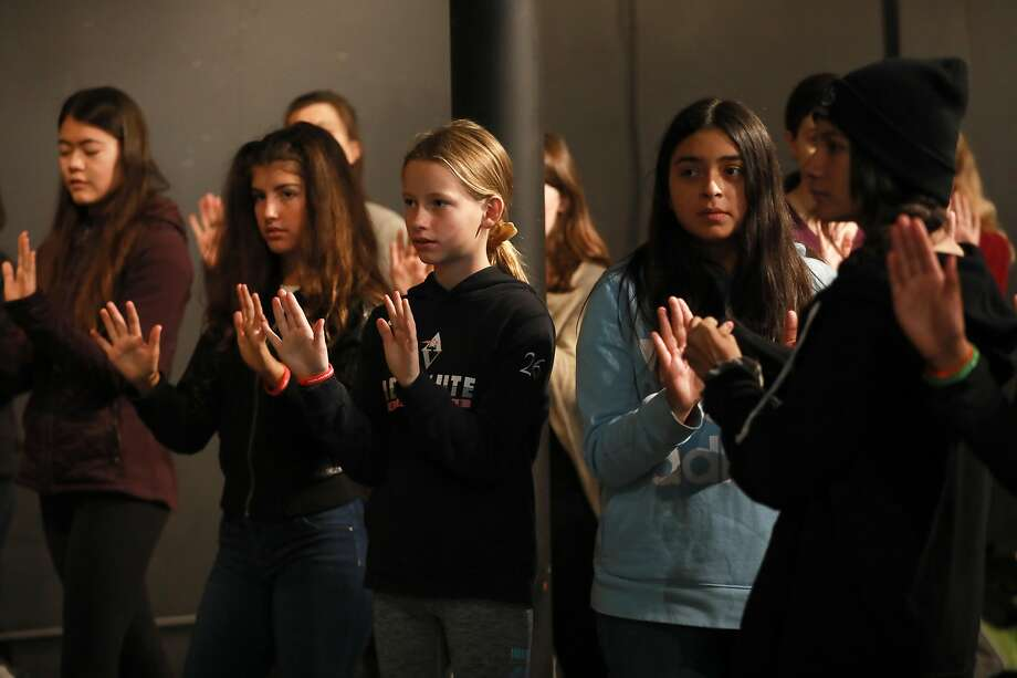 Girls listen and watch during a demonstration provided by Edge Self Defense at the Girls' Festival. Photo: Yalonda M. James / The Chronicle