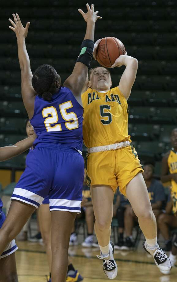 Midland College's Grace Beasley goes up for a shot as Jacksonville College's Kimberly Lillie defends 11/09/19 at the Chaparral Center during the Midland College Basketball Classic. Tim Fischer/Reporter-Telegram Photo: Tim Fischer/Midland Reporter-Telegram