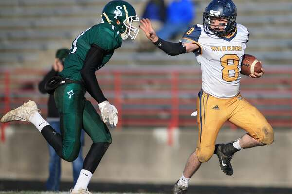 Chris Augle goes for a stiff arm in North Huron's 51-14 loss to Portland St. Patrick on Saturday, Nov. 9.