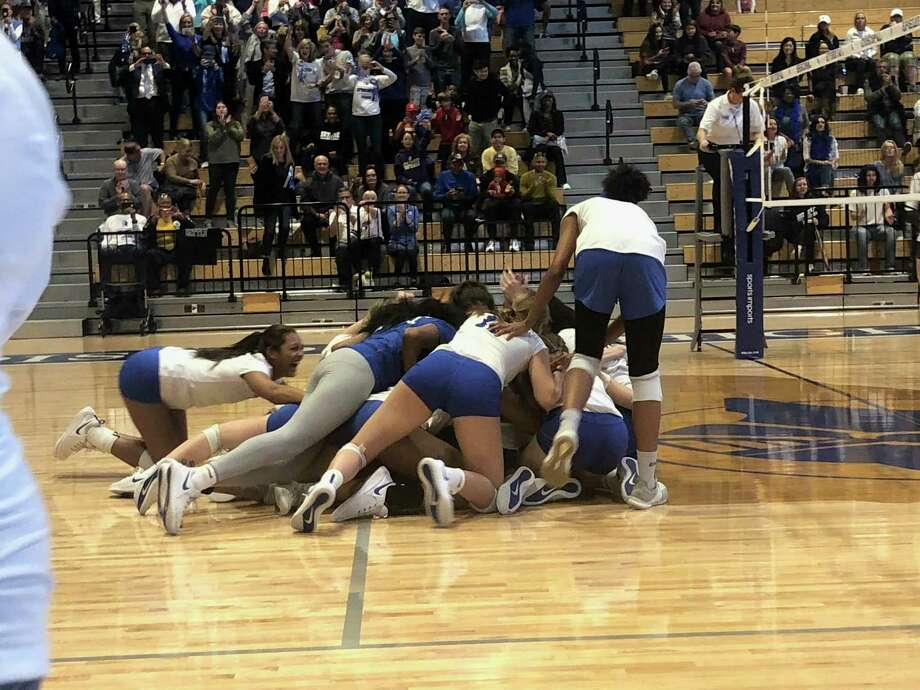 The Episcopal Knight girls volleyball team dogpiles after winning the 2019 Southwest Preparatory Conference championship at Episcopal High School on Nov. 9 Photo: Elliott Lapin / Staff Photo